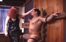 Dominant redhead playing with her slave