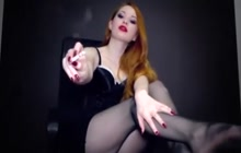 Redhead slut with a cigarette in her mouth