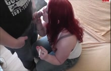 Busty redhead loves to suck cock and smoke cigarette