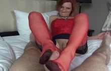 Hot mature rubs dick with feet