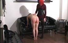 Redhead spanking a naughty chick