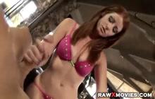 Beautiful redhead giving a nice handie